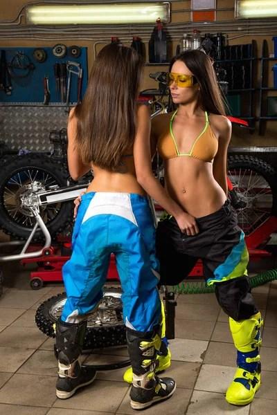 Sexy young models washing motorcycle  Stock Photo  VITAL_ML 184592474