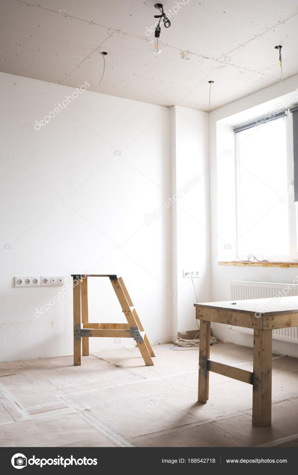medium resolution of two wooden ladders in a white interior bright room with fresh plastered walls wiring and working with electricity in the house photo by shuterdima