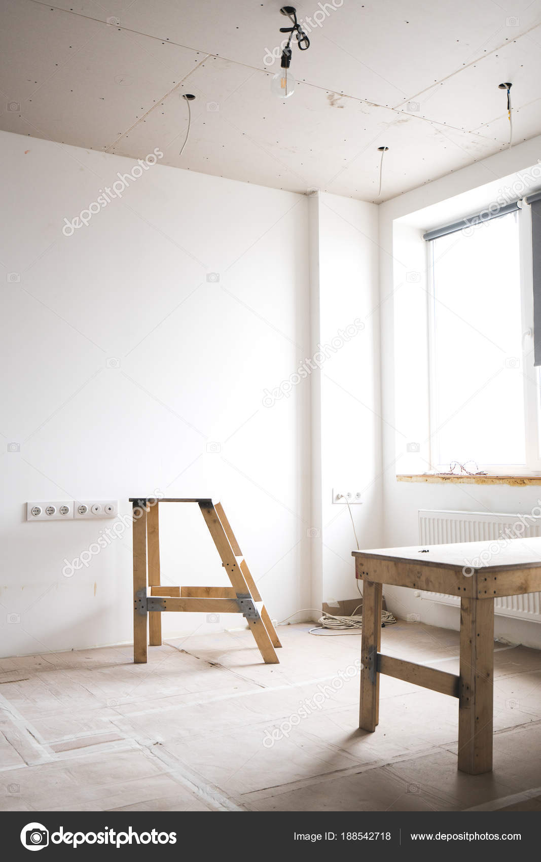 hight resolution of two wooden ladders in a white interior bright room with fresh plastered walls wiring and working with electricity in the house photo by shuterdima