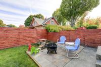 Fenced back yard with patio area and barbecue grill ...