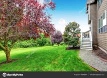 Lawn In Beautiful Yard. House Exterior