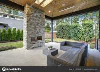 Chic patio design with vaulted ceiling and stone fireplace ...