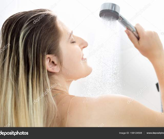 Portrait Of Young Woman With Long Blonde Hair Washing In Shower Stock Photo