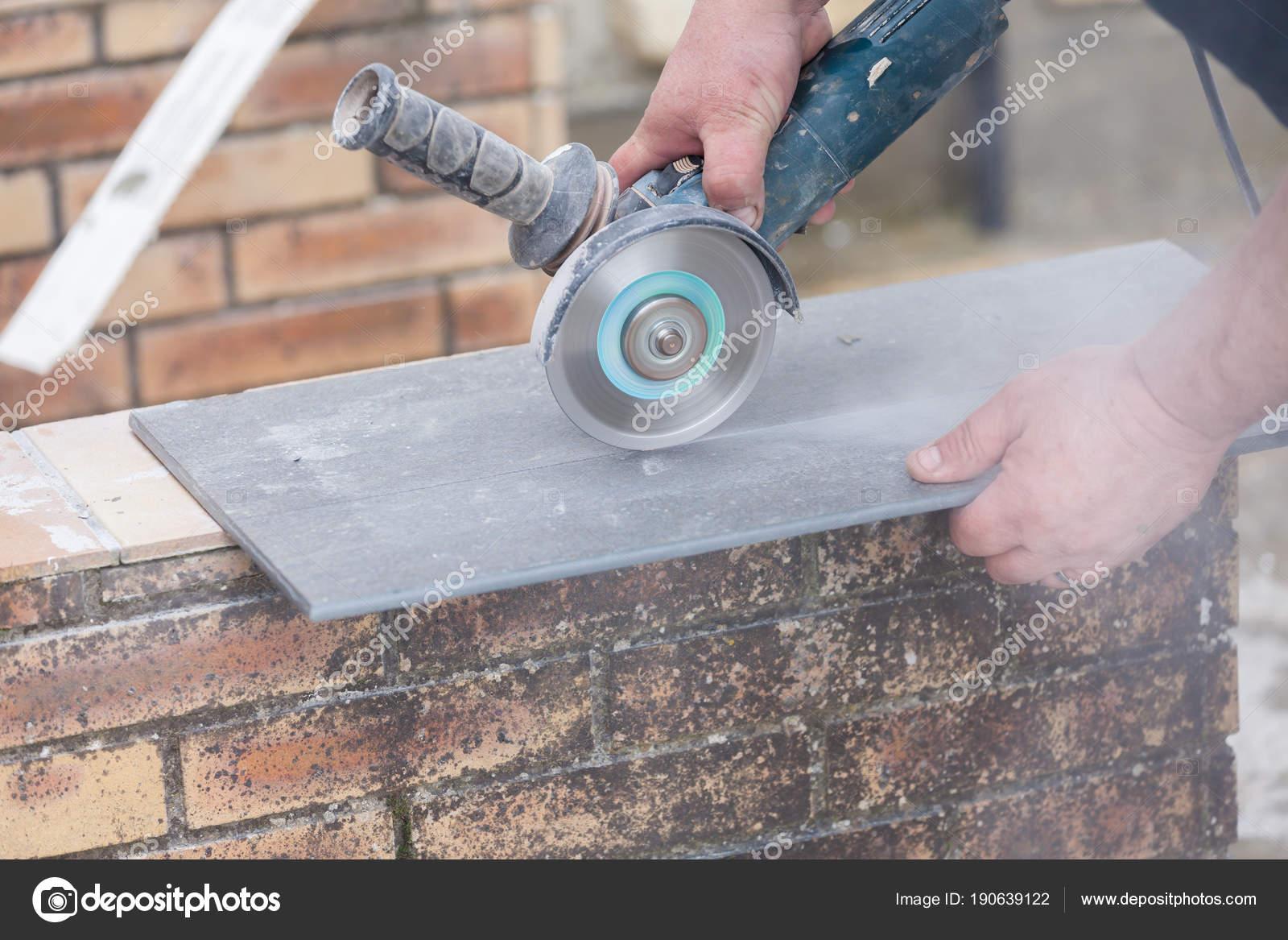 https depositphotos com 190639122 stock photo tiler cutting tile grinder construction html