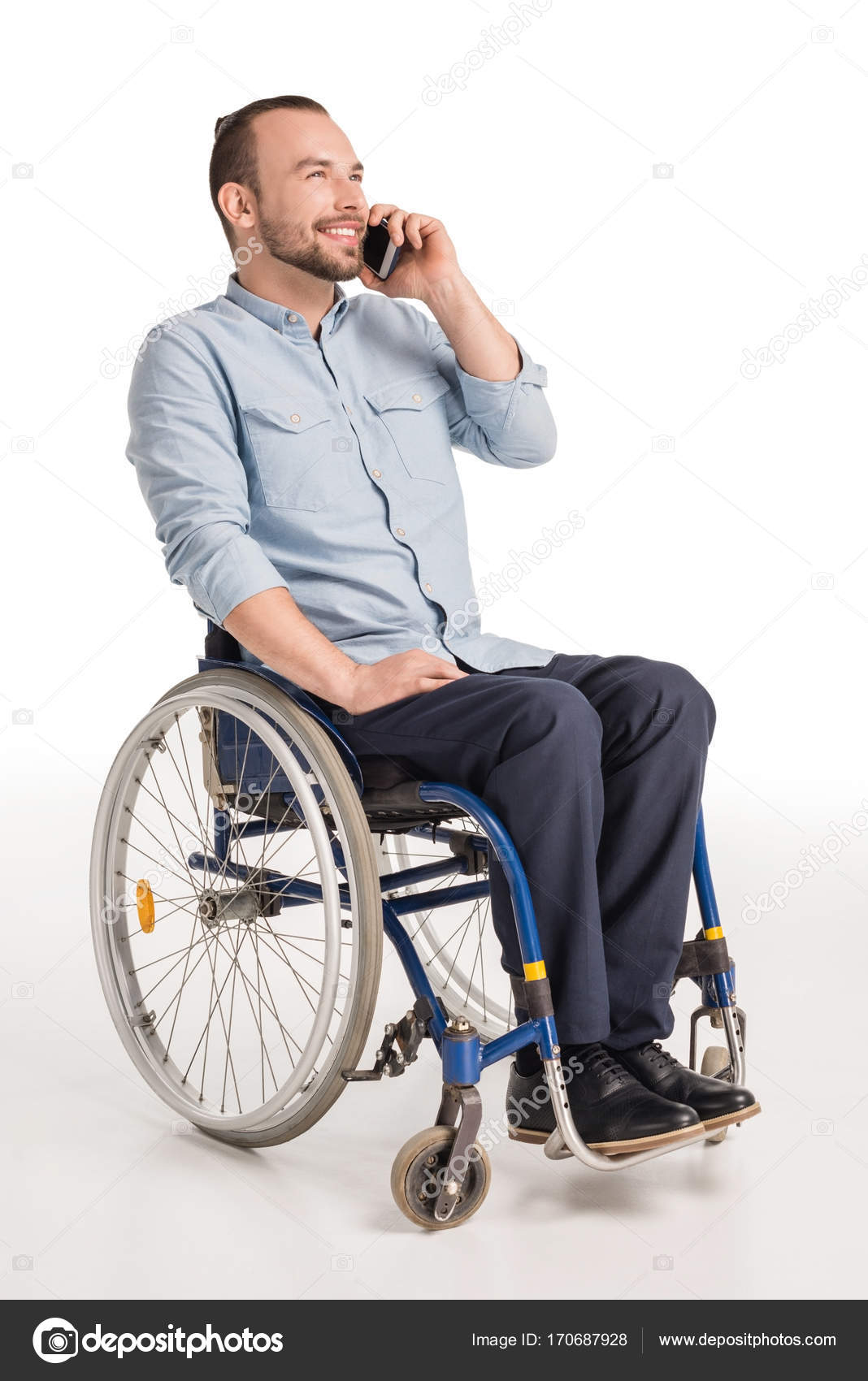 wheelchair man easy clean high chair australia in talking on smartphone stock photo