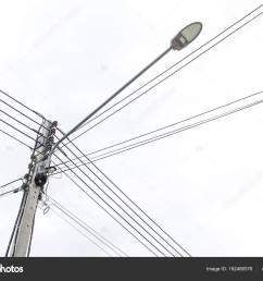 lamp post and electric pole connect to the high voltage electric wires stock photo [ 1600 x 1168 Pixel ]