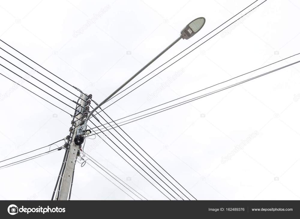 medium resolution of lamp post and electric pole connect to the high voltage electric wires stock photo
