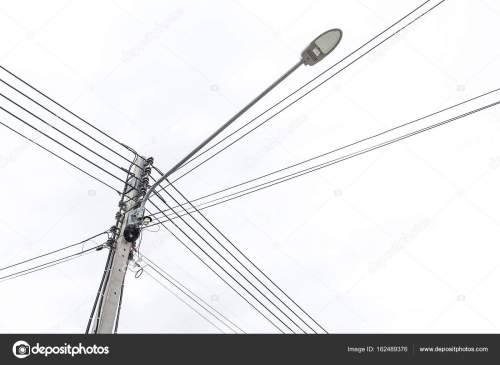 small resolution of lamp post and electric pole connect to the high voltage electric wires stock photo