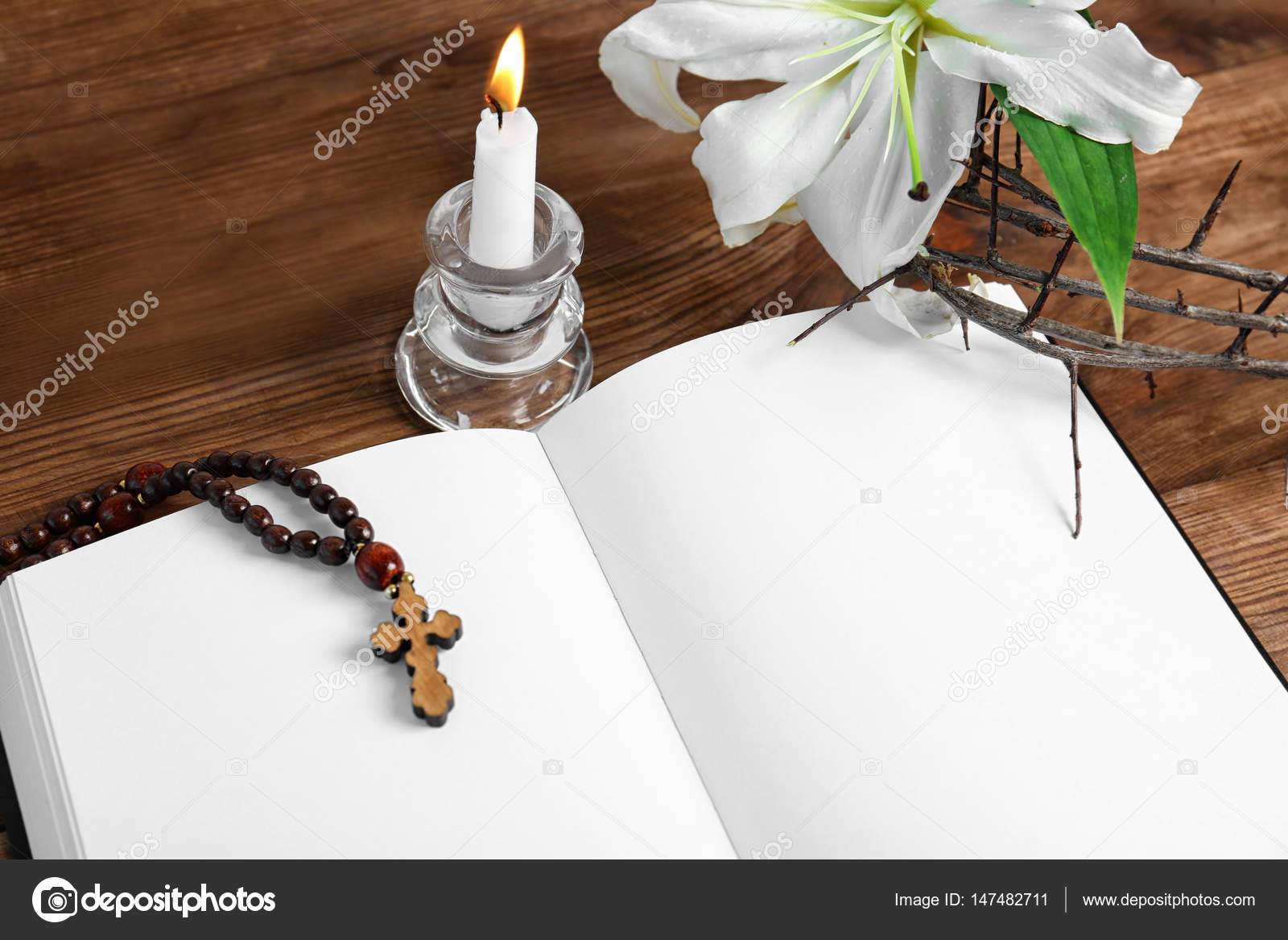 hight resolution of opened blank book candle with holder rosary and crown of thorns on wooden table photo by belchonock
