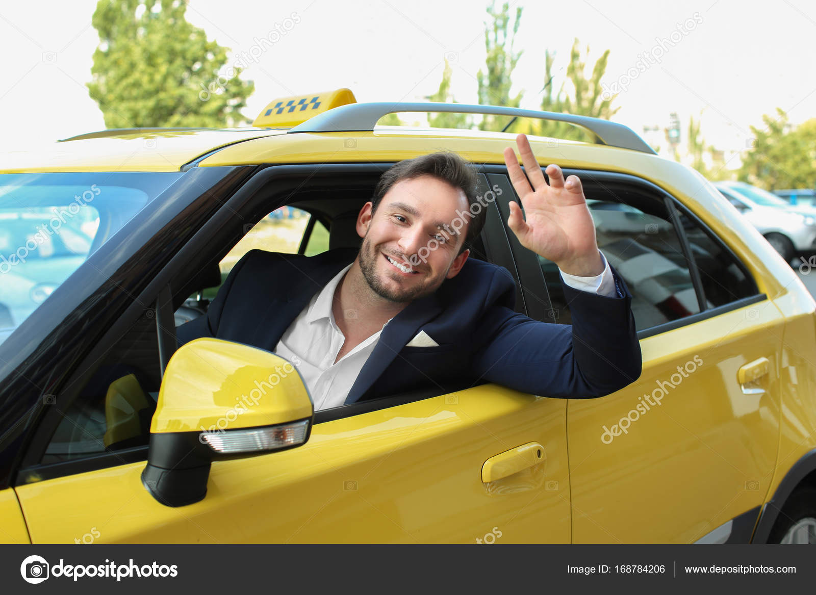 Male Taxi Driver Sitting In Yellow Car