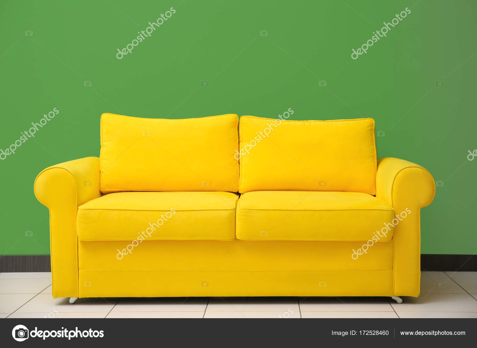 bright sofa leather and fabric sofas for sale yellow stock photo c belchonock 172528460 against green wall indoors by
