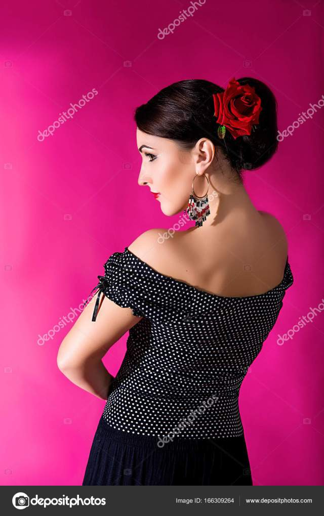 flamenco carmen beautiful woman in black dress with a red