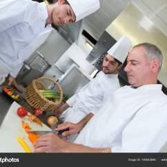 Kitchen Aid Professional Small Ideas With Island 三微笑的专业厨师在餐馆厨房一起工作 图库照片 C Photography33 194543946 照片作者photography33