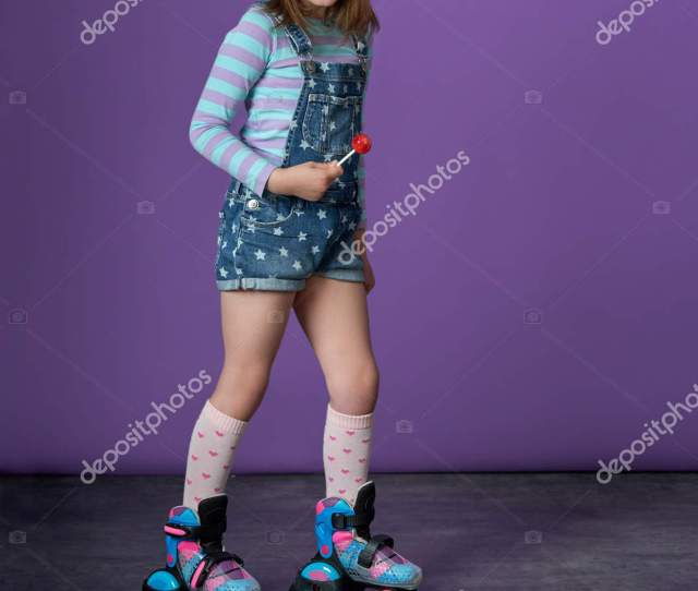 Childrens Sports Fashion Sporty Pretty Teen Girl Loves Sports Little Pretty Girl On Roller Skates In Studio On Purple Background Cheerful Girl Looking At