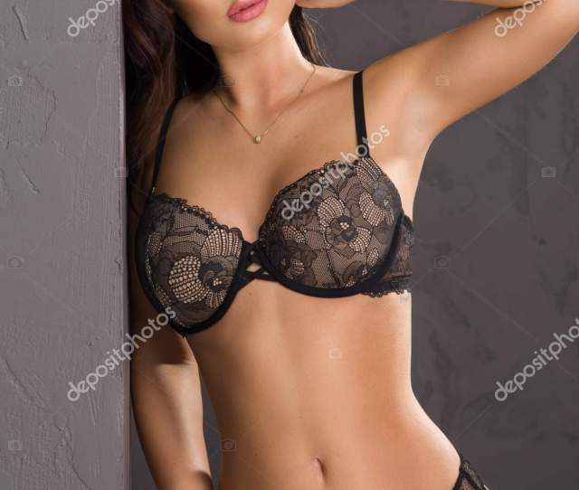 Brunette Sexy Woman Posing In Lingerie Looking At Camera Stock Image