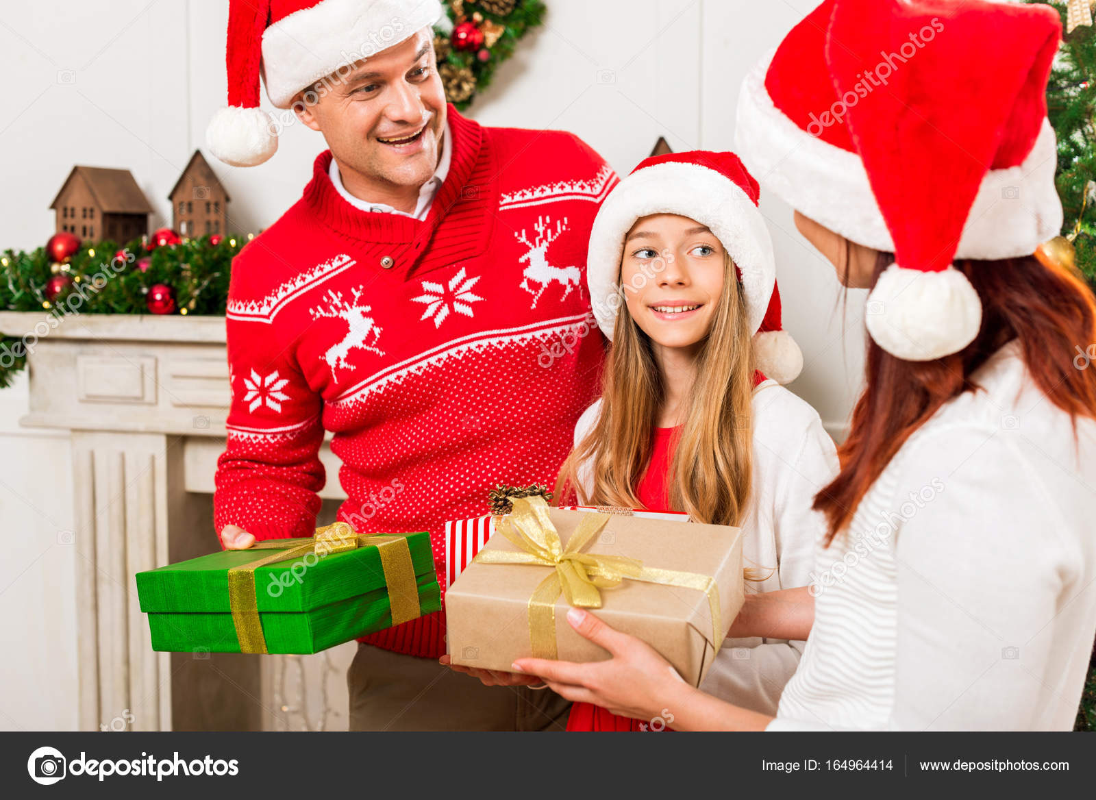 parents giving presents to