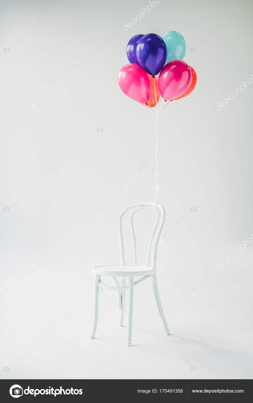 chair with balloons gray side table colorful tied to stock photo c allaserebrina 170491358 image