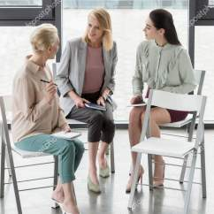 Office Sitting Chairs Bathtub Chair For Babies Attractive Businesswomen Talking Stock Photo