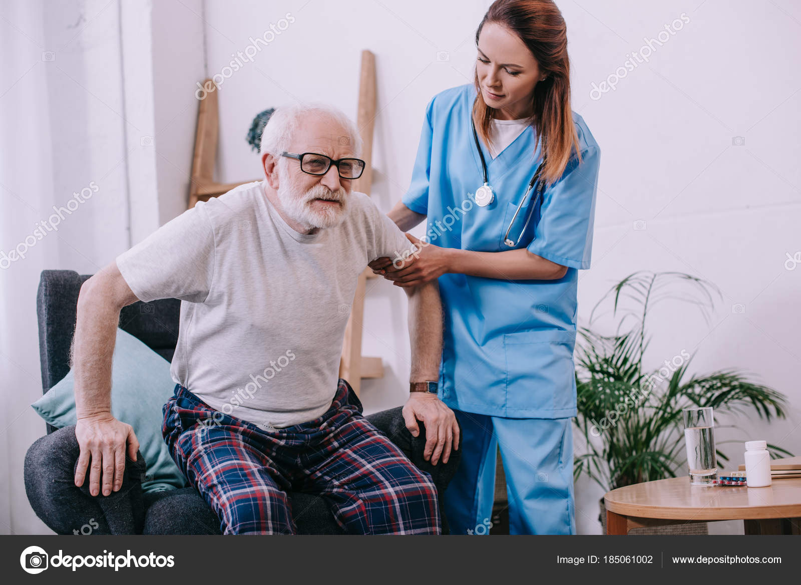 chair helps you stand up height for 30 inch table nurse helping old man  stock photo