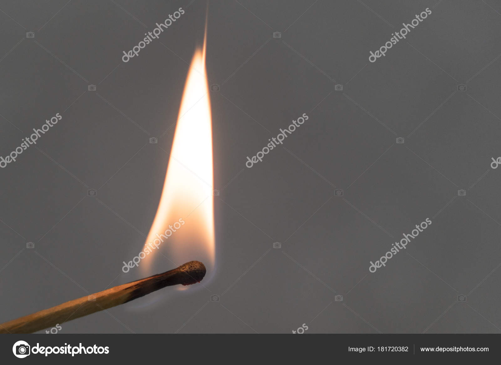 hand burning match stick