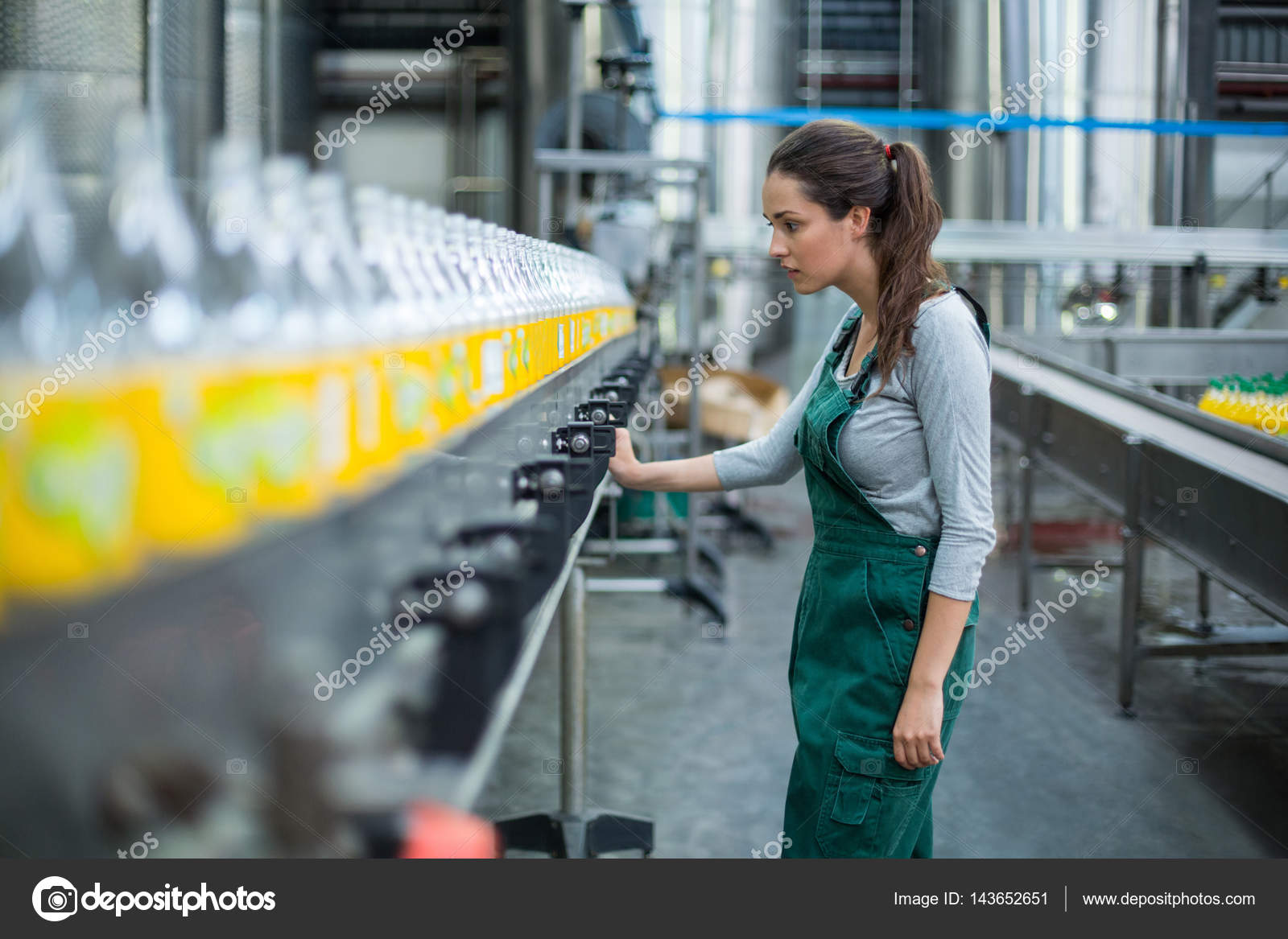 female factory worker standing