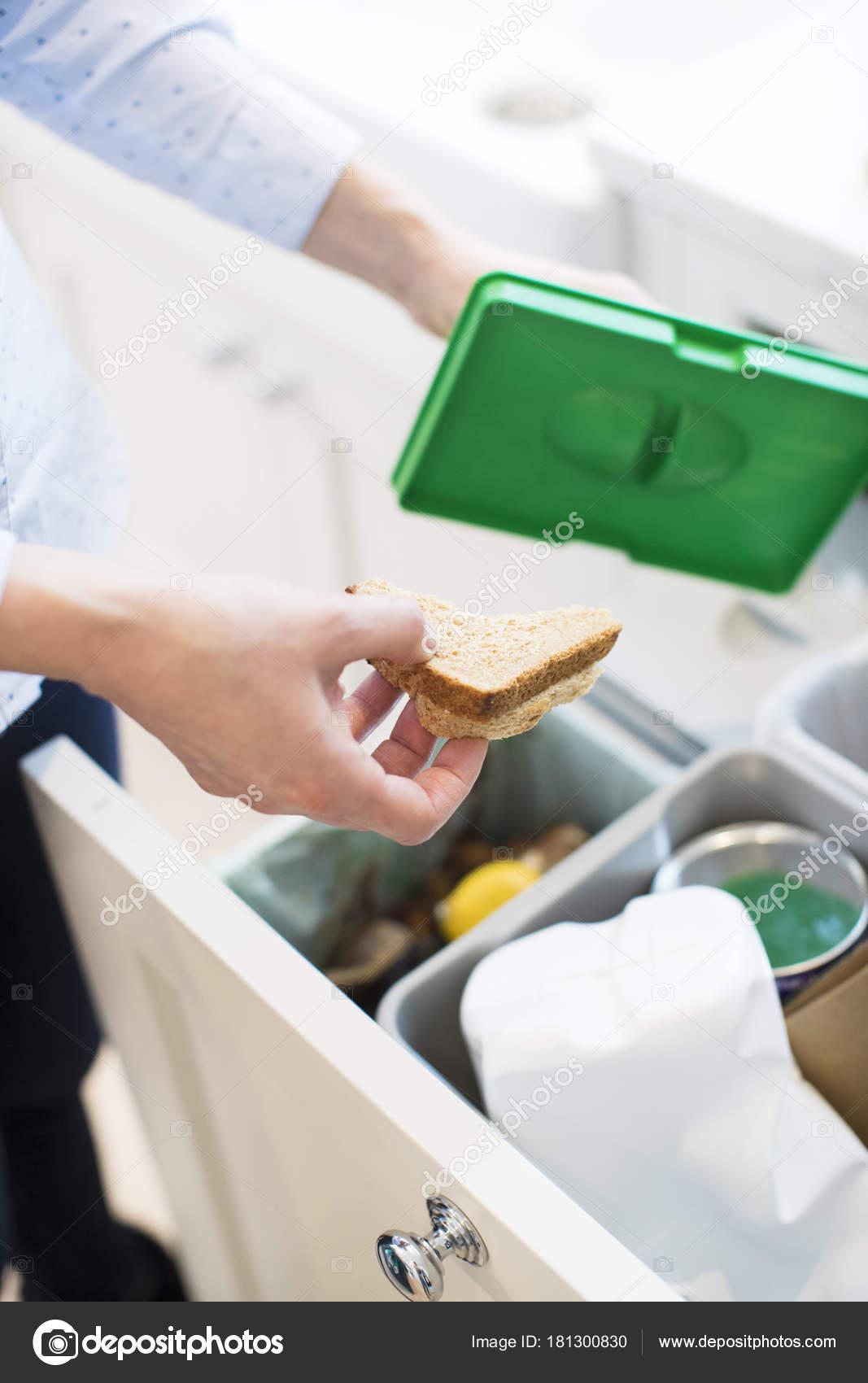 kitchen recycle bin hardware for white cabinets 在厨房里把食物渣滓放进回收站的妇女关闭 图库照片 c daisy 181300830