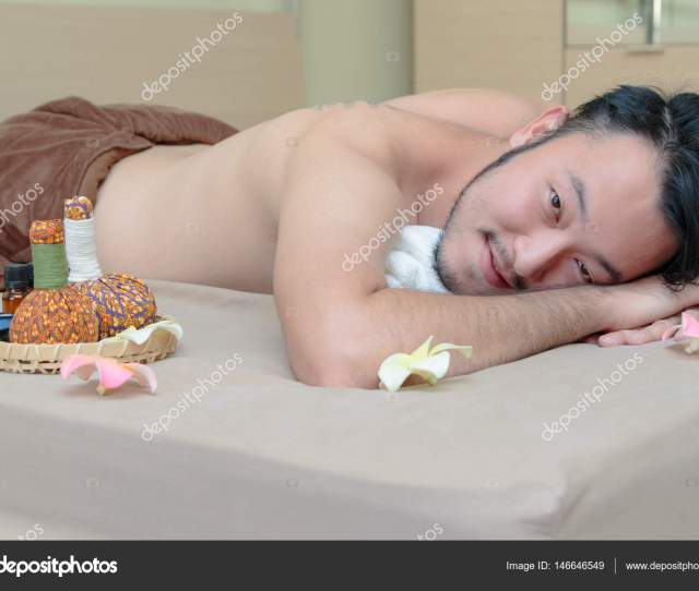 Happy Asian Man Lying On The Massage Table And Smiling Spa Conc Stock Photo