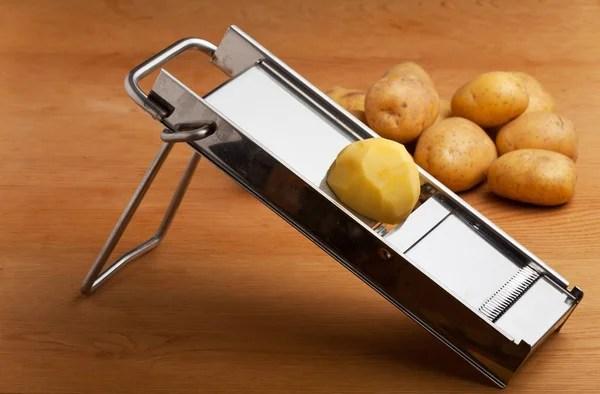 mandolin kitchen slicer unfinished base cabinets with drawers 半个土豆上曼陀林切片器 图库照片 c bernjuer 3804736 曼陀林切片器