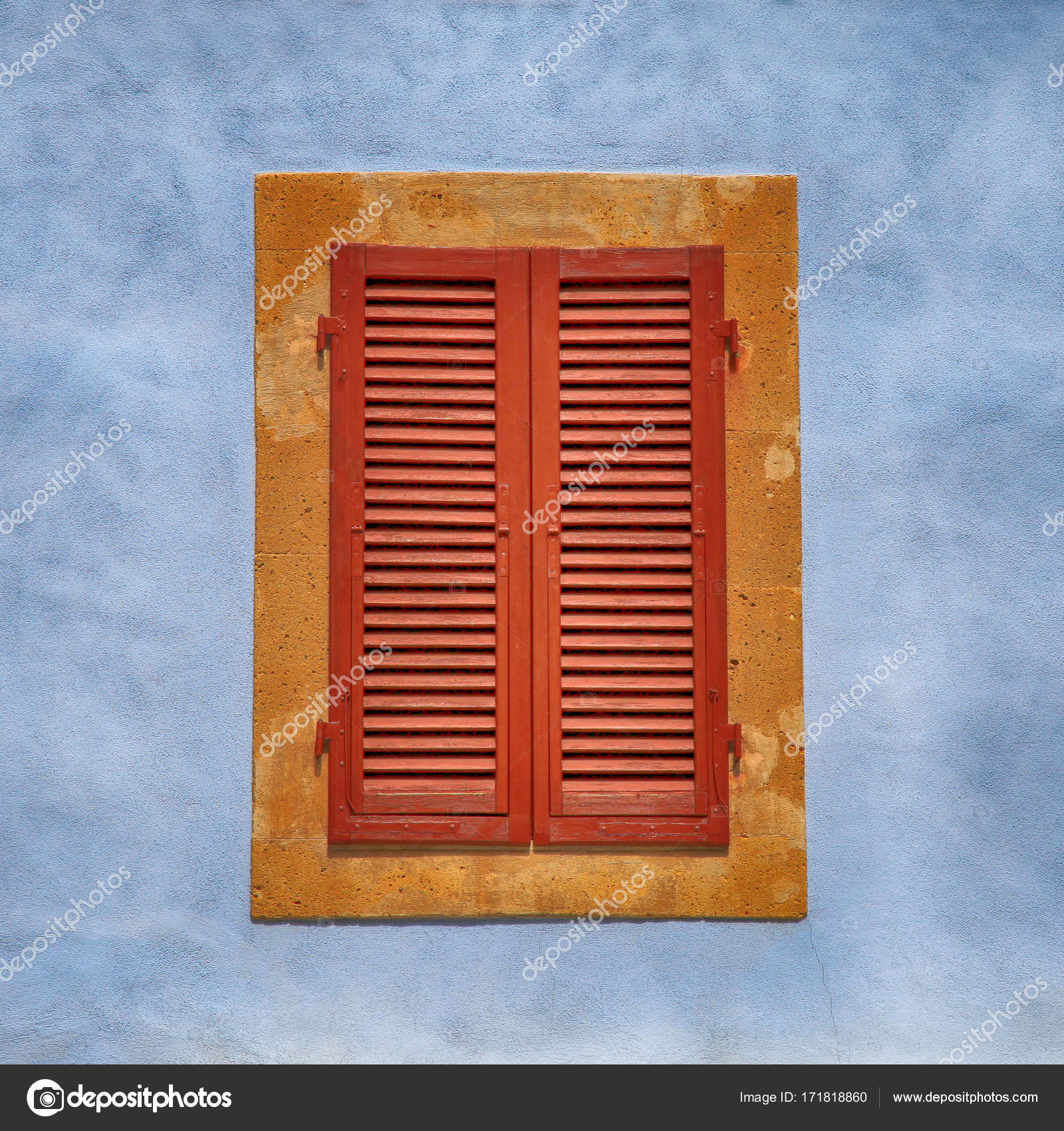 Closed Window With Brown Shutters On Blue Ancient Wall