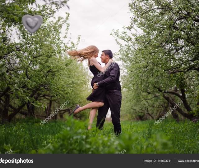 Wonderful Love Story In Photos Pretty Pair In Green Fruit Garden Stock Photo