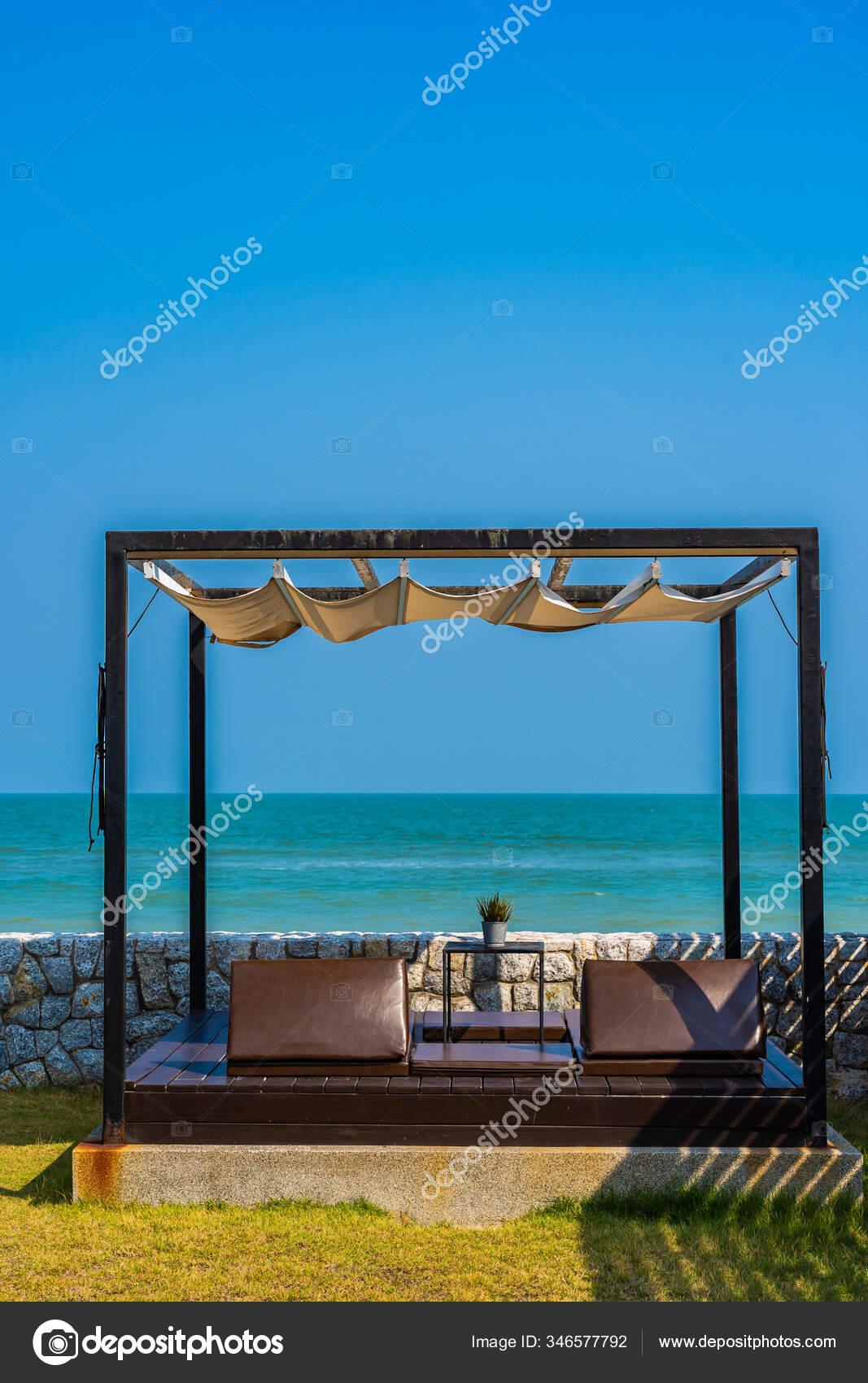 https depositphotos com 346577792 stock photo pillow sofa bed lounge beach html