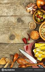 Food ingredients on a wooden background Place for text Restaurant menu Recipe for chefs Spices and stuffed green olives Stock Photo © marsan #194622470