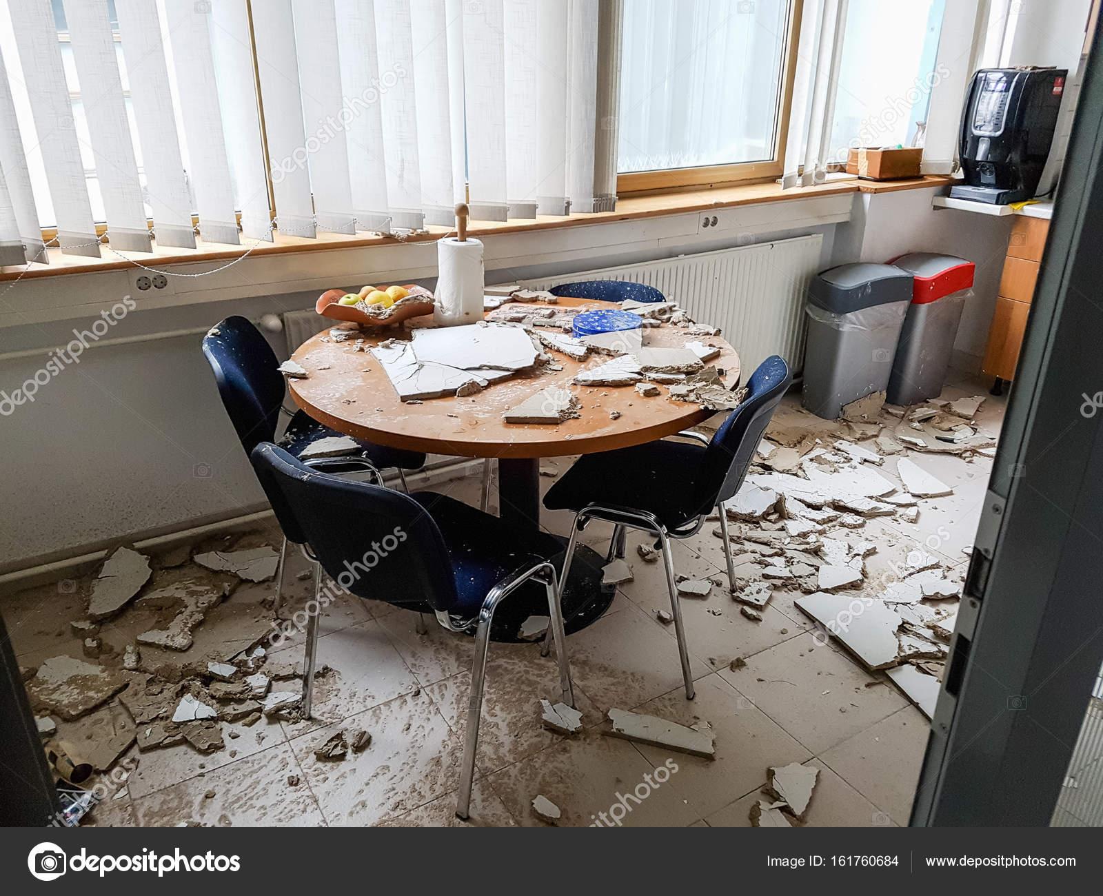 zinc kitchen table remodeling 被倒塌的天花板摧毁的厨房 图库照片 c anze bizjan 161760684