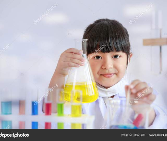 Asian Girl Doing Laboratory Test Colorful Tubes Science Classroom Stock Photo