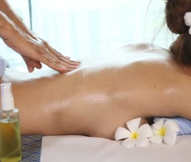 Young Woman Getting Thai Body Massage In Spa Room Stock Video