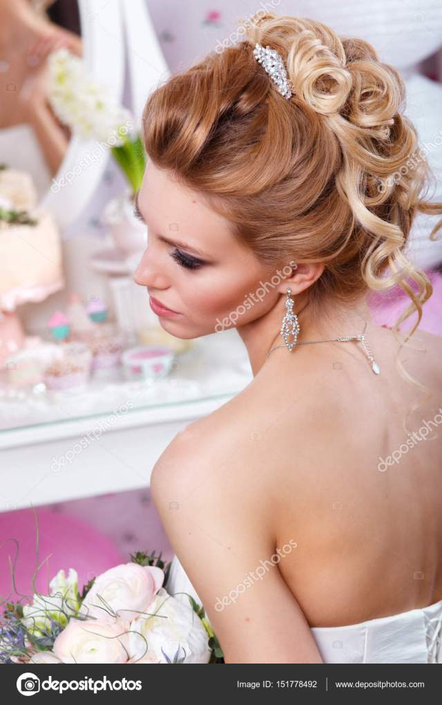 beautiful bride with fashion wedding hairstyle . hairstyle