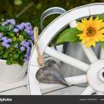 Garden Decoration Old Wagon Wheel Made Wood Sunflower Stock Photo C Panthermediaseller 340244052