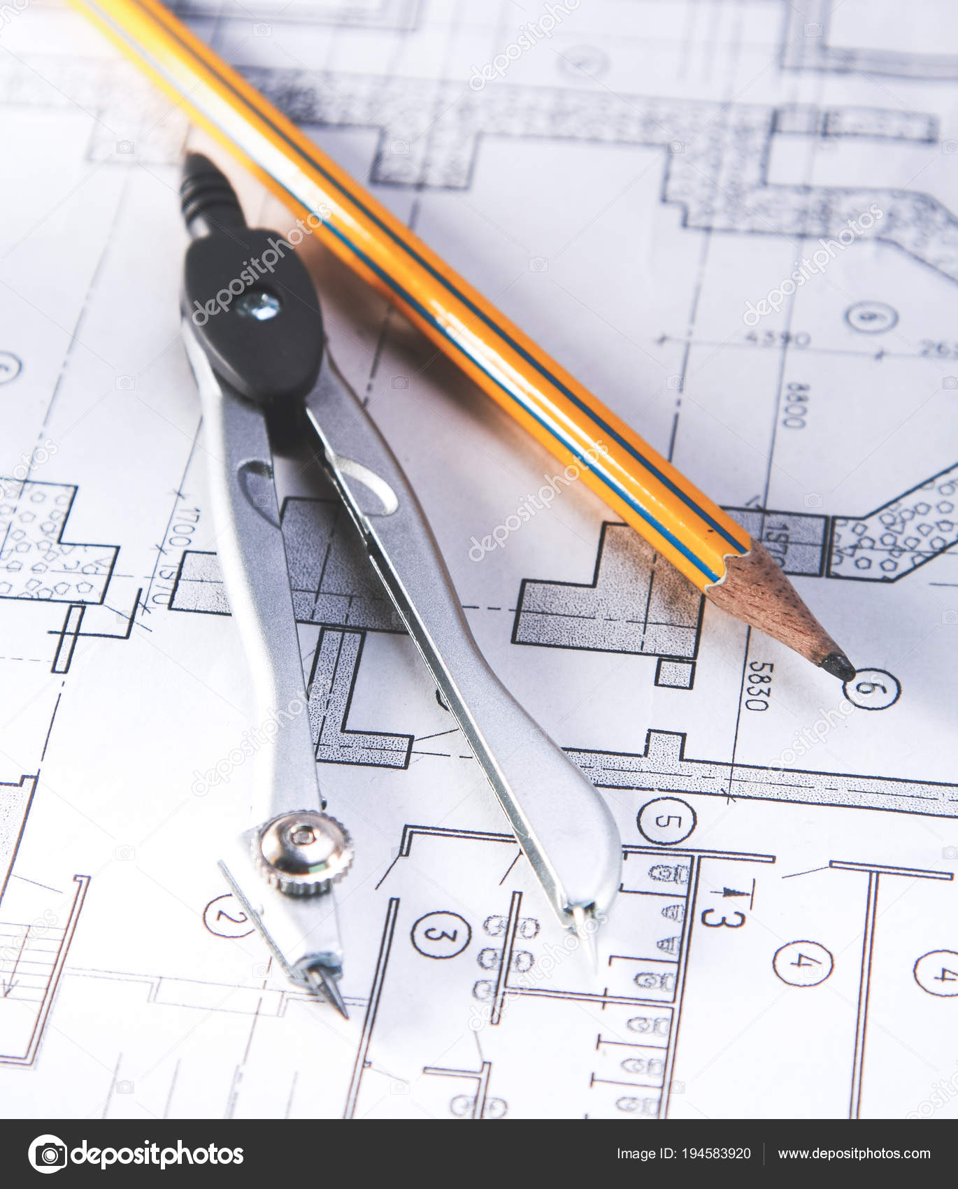hight resolution of architectural plans compass and ruler on the desk stock image
