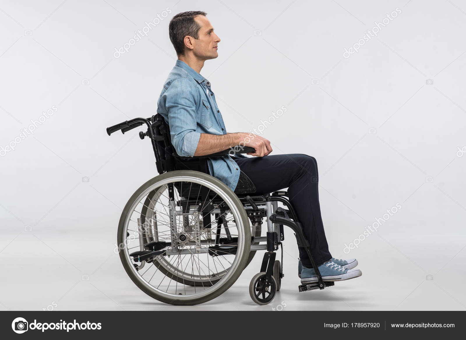 wheelchair man leather professor chair good looking crippled resting in stock photo