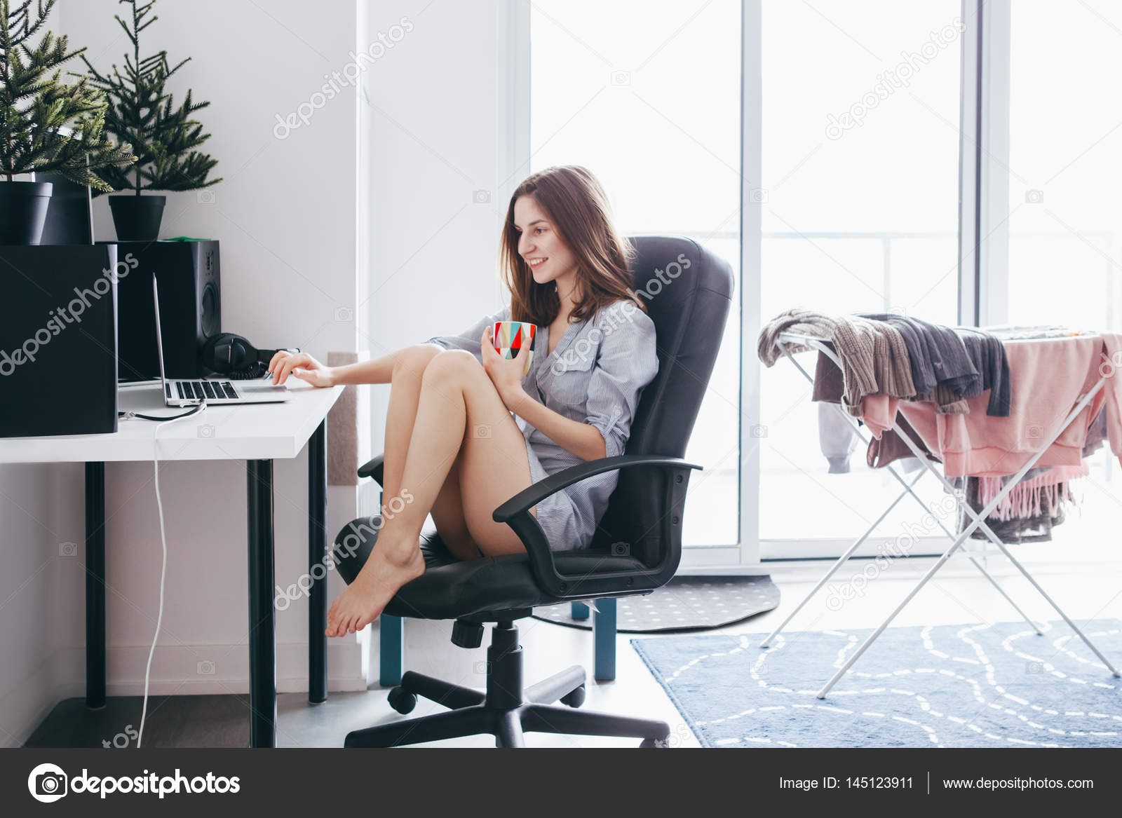 Woman sitting in office chair working  Stock Photo