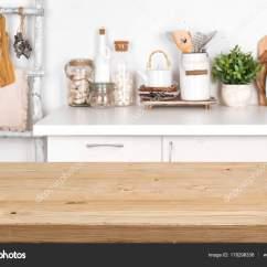 Wood Table Kitchen French Lace Curtains 厨房内有模糊图像的空褐色木桌 图库照片 C Didecs 178298336