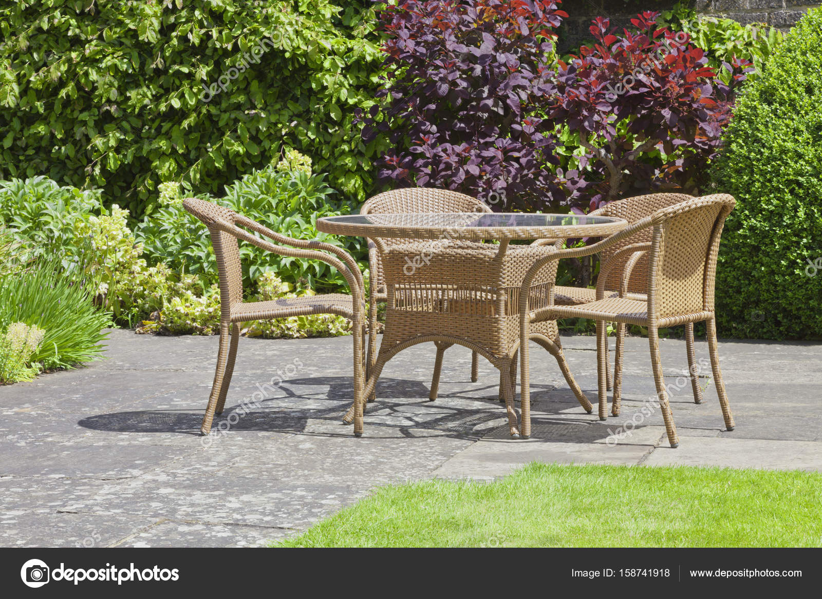 patio chairs and table in a summer garden stock photo image by c yolfran 158741918