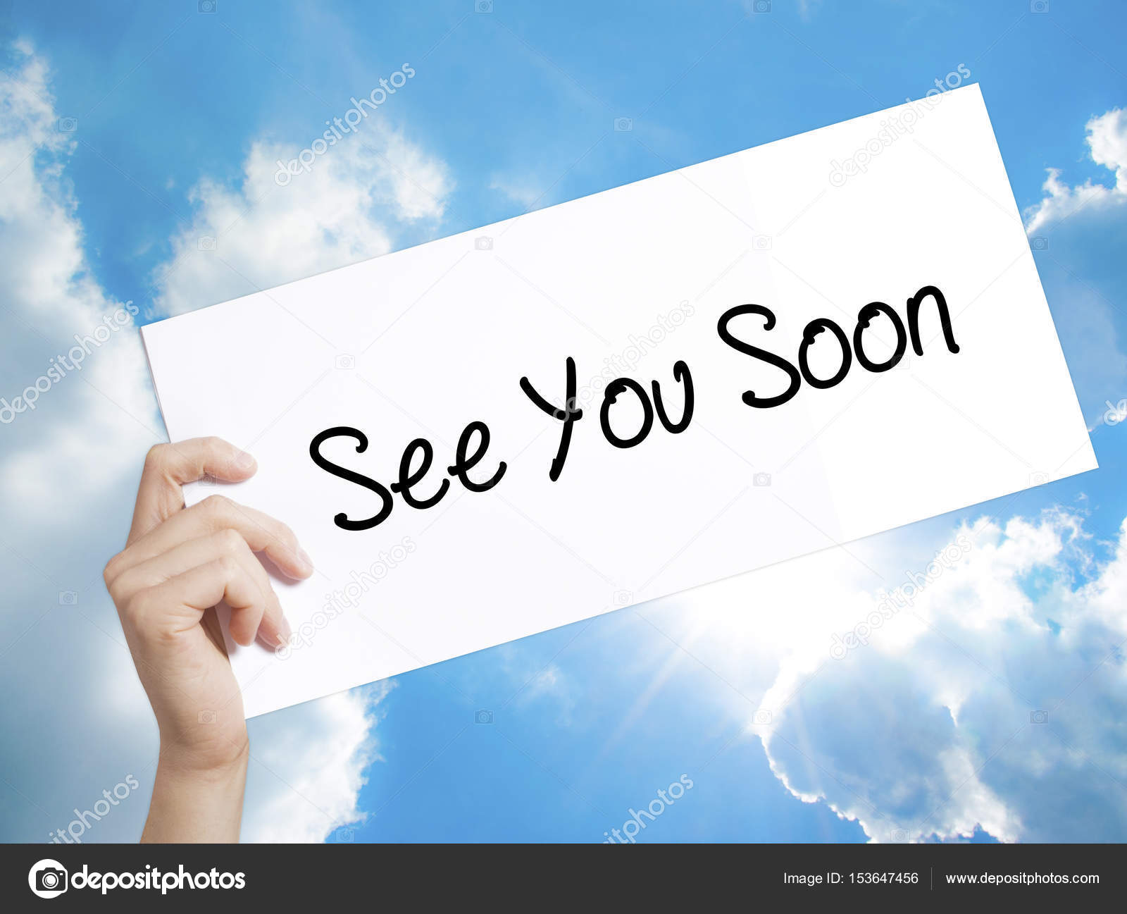 See You Soon Sign On White Paper Man Hand Holding Paper