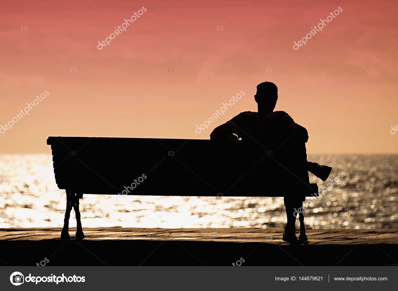 silhouette of men sitting
