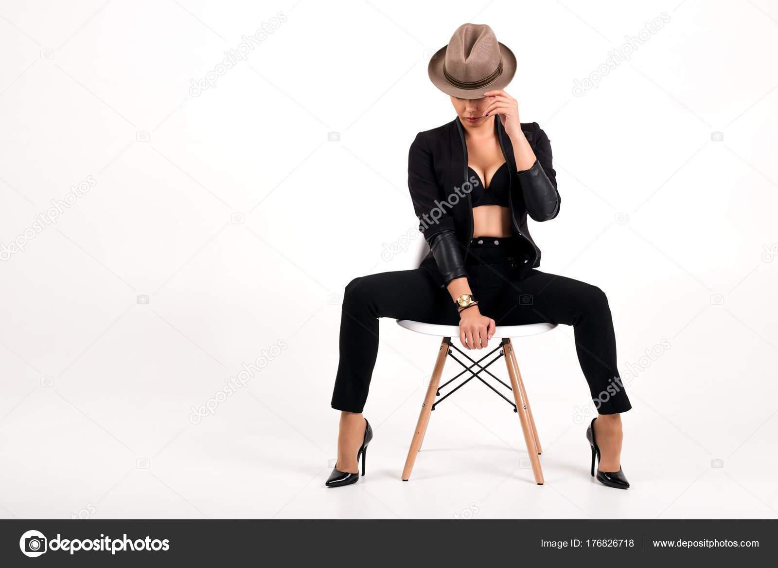 Chair Pants Sexy Woman In Pants Jacket Bra And Hat Sitting On Chair On White
