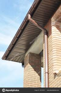 Rain Gutter Drain Pipe Downspout Installation on the ...