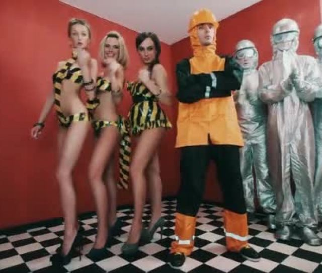 Rapper In Hazard Suit With Sexy Girls Snaps Fingers And Live Statues Clap Hands Stock