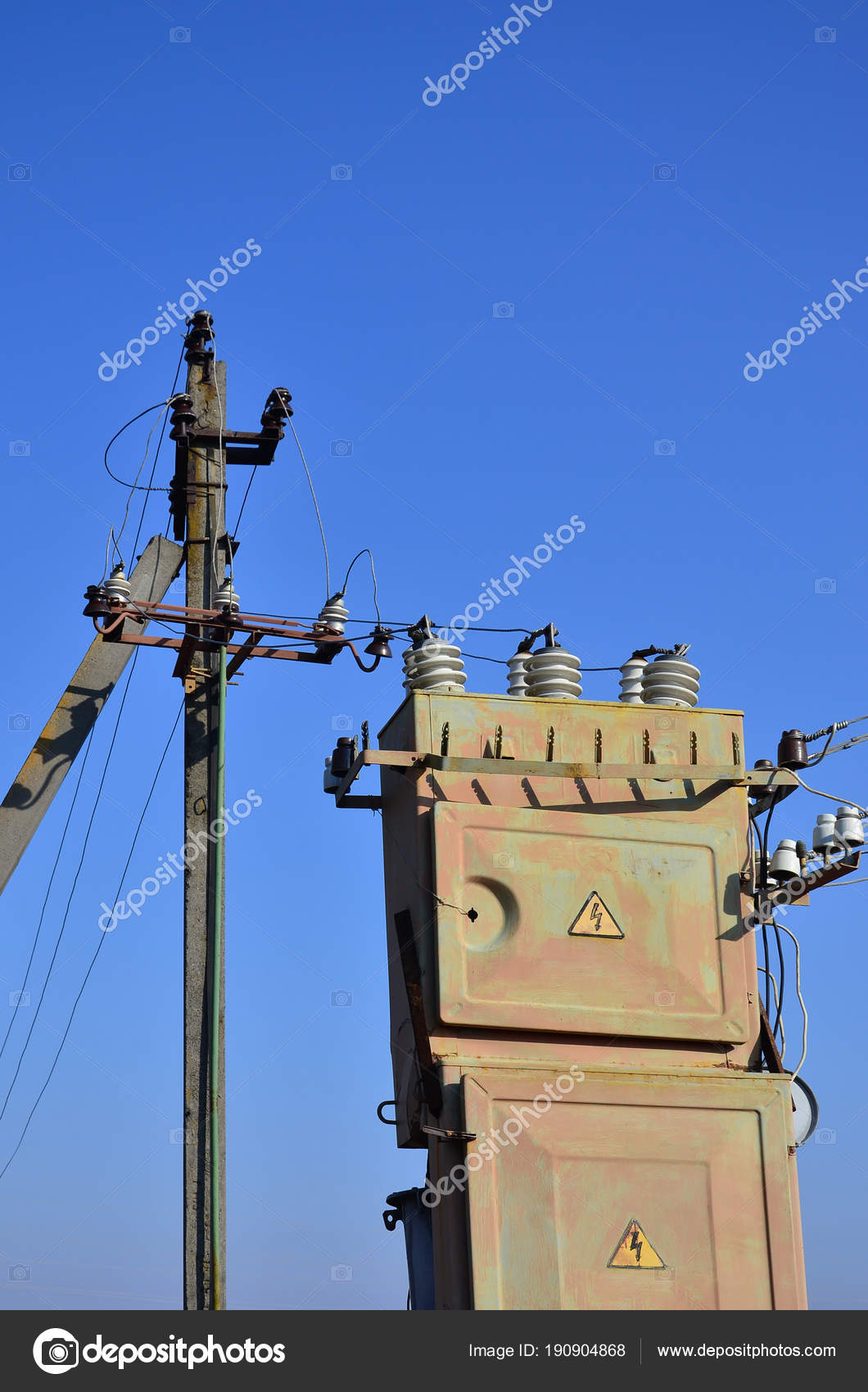 hight resolution of old obsolete electrical transformer background cloudless blue sky device distribution stock photo