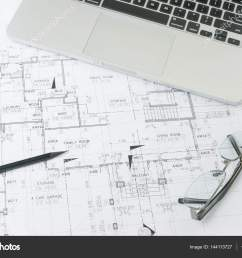 black pencil and computer laptop on architectural drawing paper for construction photo by worldwide stock [ 1600 x 1167 Pixel ]