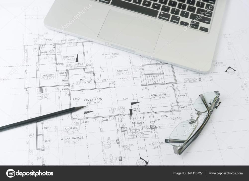 medium resolution of black pencil and computer laptop on architectural drawing paper for construction photo by worldwide stock